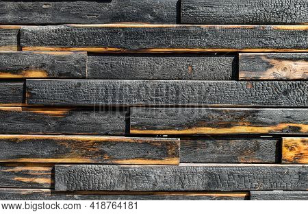 Texture Of Burnt Boards. Blackened Charred Wood Planks With Light Veins. Burnt Scratched Hardwood Su