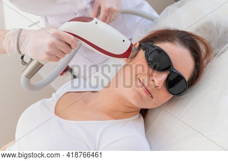 The Doctor Makes Laser Hair Removal On The Face Of A Woman In The Salon. An Alternative Way To Perma