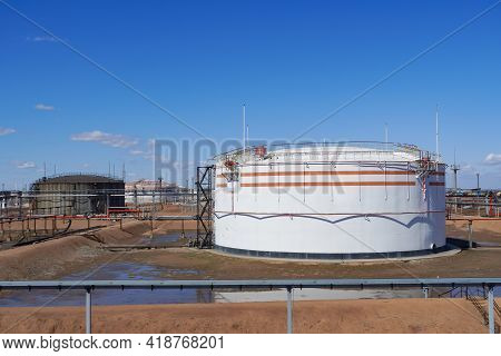 Oil Depot. Tanks For Storing Oil, Gas And Gasoline In An Oil Refinery. Oil Pipeline. Oil Refining.