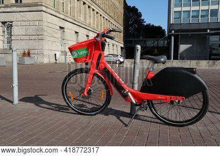 Dusseldorf, Germany - September 19, 2020: Lime Electric Rental Bicycle Parked In Downtown Dusseldorf