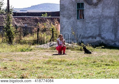 Villagers Spending Time Outdoor On Sunny Day, People On Village Street In Viscri, Romania, 2021