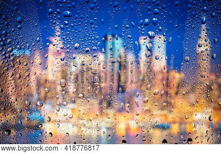 Beautiful Landscape Conceptual View Of The City Through Glass Window With Raindrops. Rain At Urban N
