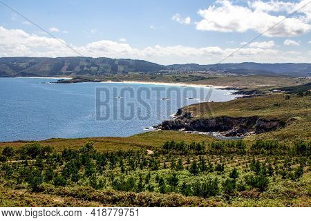 Natural Bay With Calm Water Surrounded By Mountains On A Sunny Day In Galicia, Spain.