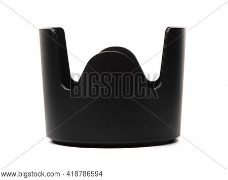 Black plastic lens hood for the camera lens, isolated on white background