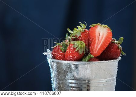 Red Strawberries In A Metal Bucket Closeup In A Blue Background. Multivitamin Cocktail. Healthy Life