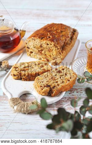 Traditional English Tea Raisins Cake With Candied Orange, Egg-free Cake And Cup Of Tea. Five Clook T