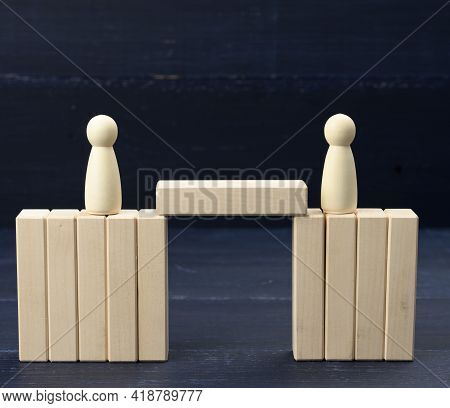 Wooden Figures Of Men On A Bridge Made Of Blocks. The Concept Of A Dispute Between Opponents, Dialog
