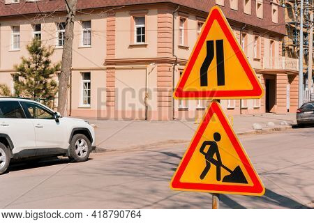 Traffic Warning Sign For A Road Narrowing On The Left And Triangle Road Sign Work In Progress On A S