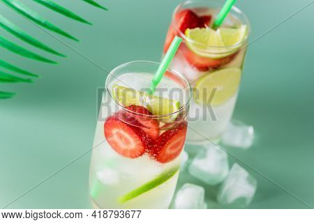 Glass Of Tasty And Cold Strawberry And Lime Lemonade Summer Cold Drink Green Background Horizontal