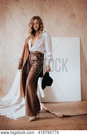 Girl In A Trendy Spring Set Of Beige And Brown Clothes. Natural Colors. Trend Of 2021 Total  Beige.