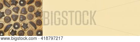 Chocolate Banner.chocolate Candy On Beige Background.sweets And Chocolate.chocolate Truffles Assortm