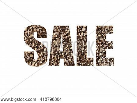 Brown Texture Of Instant Coffee. Shot Through The Cut-out Silhouette Of The Word Sale