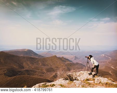 Side View Young Attractive Caucasian Hipster Woman Content Creator Photographing Mountains With Red