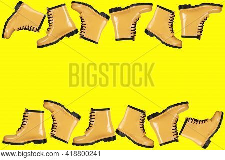 Creative Background With Yellow Rubber Boots On Yellow Background.lots Of Women's Rubber Boots.autum
