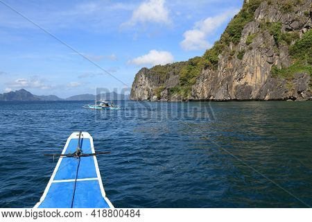 Onboard Traditional Bangka Boat In Philippines Island Hopping Tour. Philippines Coast Landscape.