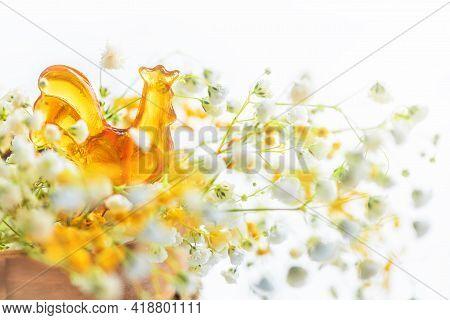 Lollipop Honey Cockerel On A Stick Among Spring Flowers