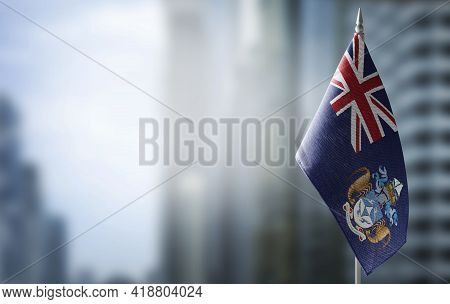 A Small Flag Of Tristan Da Cunha On The Background Of A Blurred Background