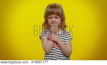 Unhealthy Little Blonde Teen Child Kid Girl Coughing Covering Mouth With Hand, Feeling Sick, Allergy