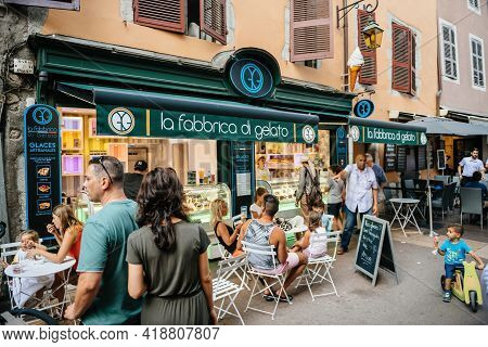 Annecy, France - Aug 15, 2017: People At The Terrace Of La Fabbrica Di Gelato Ice Cream Factory Cafe
