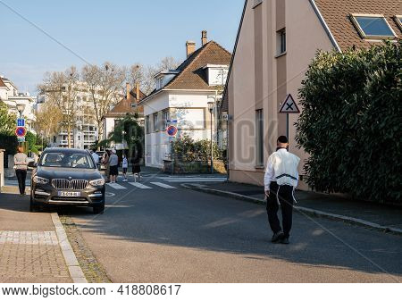 Strasbourg, France - April 9, 2020: Rear View Of Jewish Ultraortodoxos Man In Holiday Easter Clothes