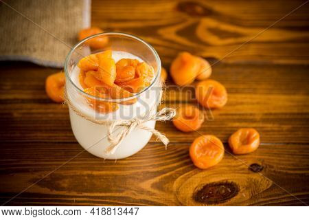 Homemade Sweet Yogurt In A Glass With Dried Apricots
