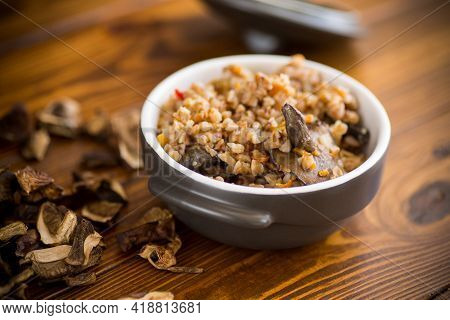 Boiled Buckwheat With Organic Forest Dried Mushrooms In A Ceramic Bowl
