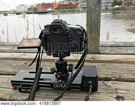WESTPORT, CT, USA - APRIL 19, 2021:   Camera set up on motion slider ready for time lapse photography