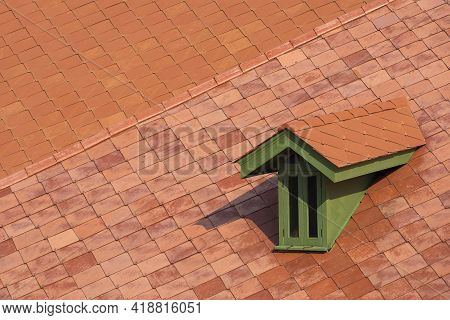 High Angle View Of Green Attic Window On Flat Concrete Tile Roof In Vintage Style