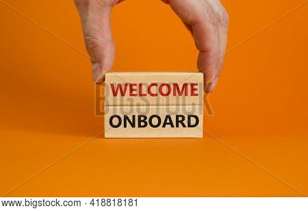Welcome Onboard Symbol. Wooden Blocks With Words 'welcome Onboard' On Beautiful Orange Background. B