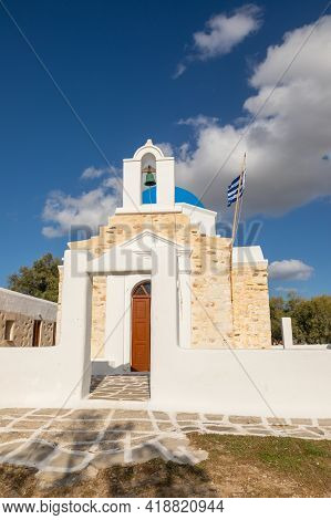 View Of The Agios Fokas, Traditional Orthodox Greek Church. Stone Facade, Belfry With A Green Bell.