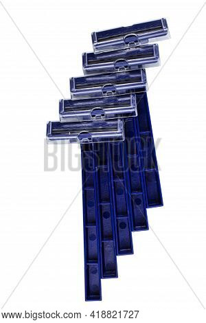 Set Of Cheap Disposable Razors On White Isolated