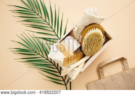 Natural Soap, Washcloth, Eco Bamboo Toothbrush, Wooden Comb, Natural Bristle Brush On A Beige Backgr