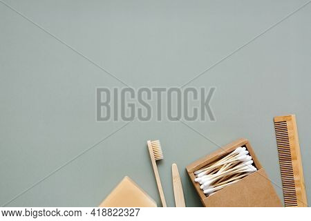Natural Soap, Bamboo Toothbrush, Wooden Comb, Bamboo Cotton Swabs On A Green Background, Top View. Z