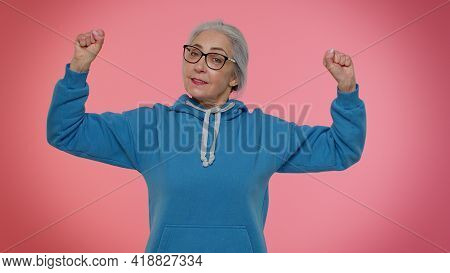 I Am Strong And Independent. Senior Old Granny Woman Showing Biceps, Looking Confident, Feeling Powe