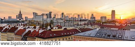 Cityscape Of Warsaw. Roofs Of The Old Town And Skyscrapers Against A Beautiful Sunset Sky, Warsaw, P