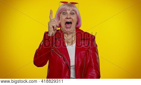 Inspired Mature Old Granny Woman With Pink Hair In Red Leather Jacket Pointing Finger Up With Open M