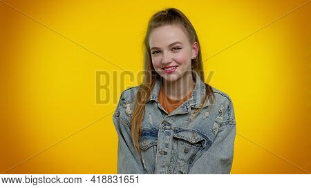 Cheerful Lovely Beautiful Teenager Student Girl In Denim Jacket Smiling And Looking At Camera. Young