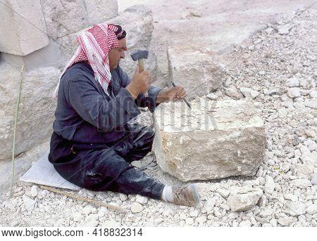 Jerash,jordan-april 27,2018:arab Stonemason At Work To Restore The Ancient City Of Jerash