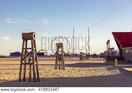Empty Beach Of The Popular Tourist Destination, Ocean City, Maryland. Image Shows An Afternoon View