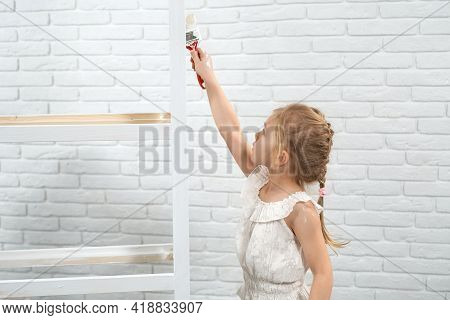 Close Up Of Girl In White Shirt Holding Brush And Painting Rack In White Color. Concept Of Process P