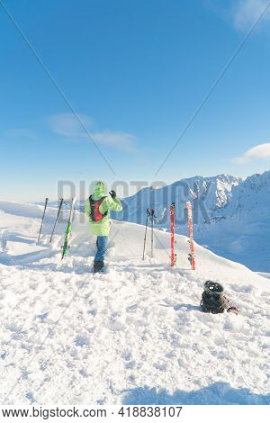 Kasprowy Wierch, Poland 28.01.2021 - Back View Of A Mountaineer On The Sloppy Landscape Enjoying The