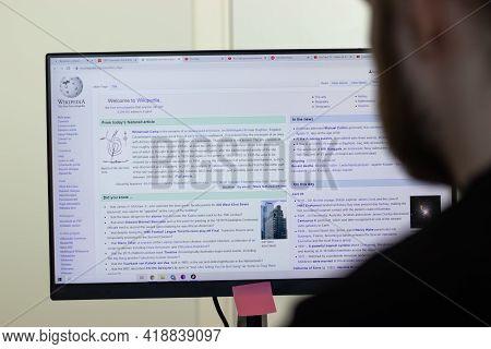 New York, Usa - 26 April 2021: Wikipedia Website Page On Screen, Man Using Service, Illustrative Edi