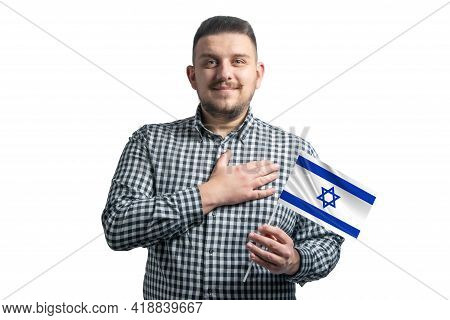 White Guy Holding A Flag Of Israel And Holds His Hand On His Heart Isolated On A White Background Wi