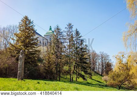 View Of Olesko Castle From Spring Garden. Ancient Architecture, Landmarks, Places Of Interest In Wes