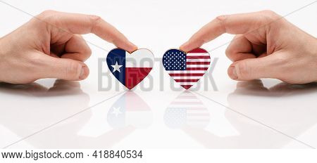 The Concept Of Friendship And Diplomatic Relations Between Texas And Usa. Two Male Hands Are Holding