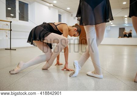 Three young ballerinas, teens rehearsal in class