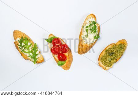 Bruschetta, A Very Tasty Snack Of Fried Bread Slices, Is One Of The Symbols Of Gastronomic Italy. Wi