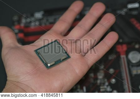 Man Hand Hold Desktop Pc Cpu Processor Over Hi Tech Motherboard, Computer Components Chip