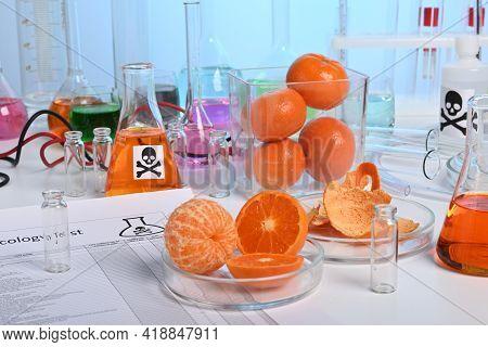 Toxicology Lab Test Of Natural Orange Juice. Orange Juice Imitation Production In Chemical Laborator