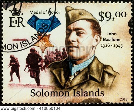 Moscow, Russia - April 27, 2021: Stamp Printed In Solomon Islands, Shows John Basilone, Us Marine Co